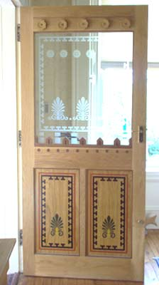 photograph of a bespoke oak door made in the style of Alexander Thomson or Greek Thomson as he is sometimes known