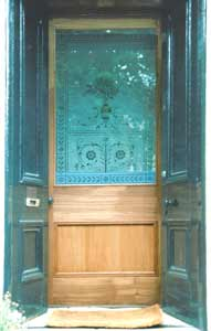 photograph of a handmade door with acid etched glass